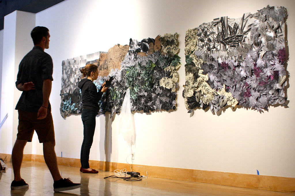 Nyssa Zinn installs her collage panoramic piece for the Masters of Fine Arts Thesis Exhibition at the Fine Arts Gallery on campus, Friday, April 12, 2013. Photo by Gabriella Gamboa / Xpress