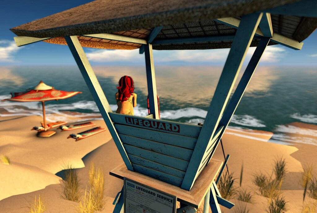 Freya Cloudring as lifeguard at the beach