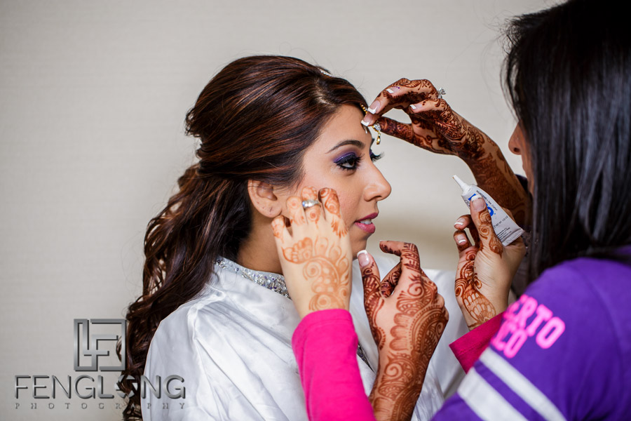 Indian Ismaili bride preparing for reception