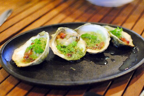 grilled oysters of the day chipotle, pickled onion, Mexican cheese