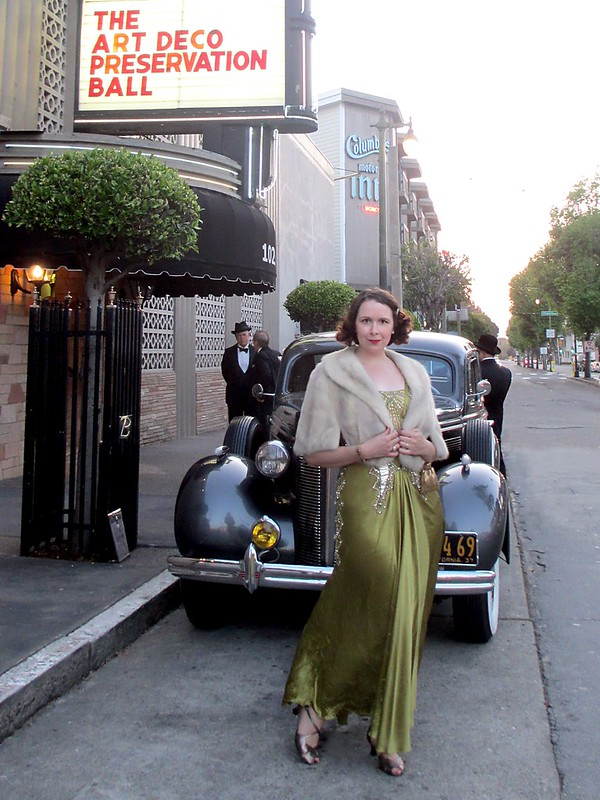 Arriving at the Art Deco Preservation Ball in a Mikael Aghal gown and vintage stole. Photo by Pat Zimmerman.