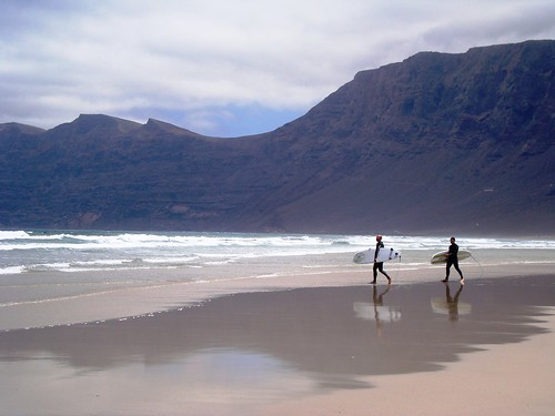 Surfers in Playa de Famara - Lanzarote