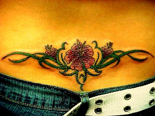 Lower Back Flower with vines tattoo