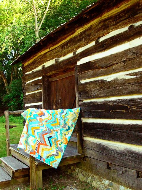 improv chevron quilt on the porch