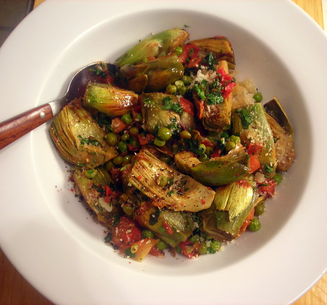 Braised baby artichokes, with plum tomatoes, peas and herbs