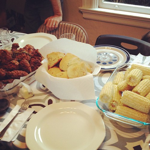 Sunday family dinner: ruhlman's fried chicken, corn, coleslaw, asiago rosemary and chive biscuits and peach/apricot pie