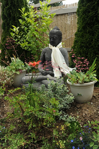 Buddha meditating on a flower, blessed statue wearing a khatag, reaching liberation through meditation, overcoming cognitive obscurations - the Bodhisattva vehicle, Garden for the Buddha, Seattle, Washington, USA