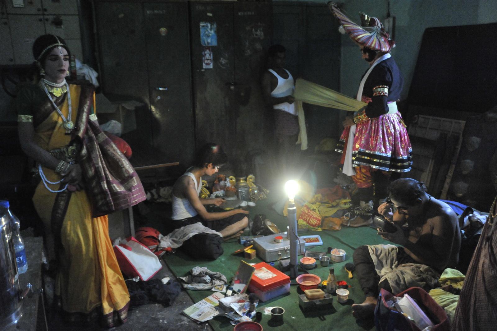 Other characters at various stages of make-up, back stage. Yakshagana, Kichaka Vadha