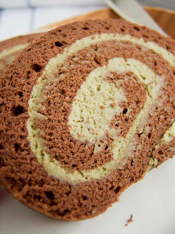 Flourless chocolate souffle roll with green tea mousse cream
