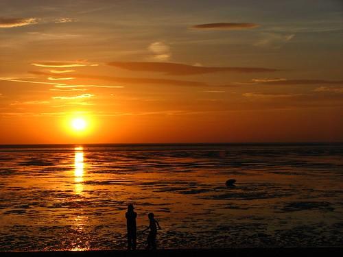 boys at sunset beach