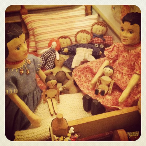 Sisters playing with their dolls