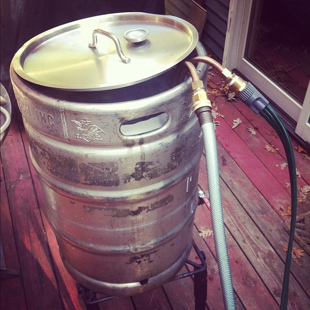 Cooling the wort using a clever cold water system, transferring the heat energy through a copper coil and hoses.