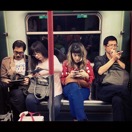 Modern living  #cellphone #mobile #communication #digital #iphone #ipad #apple #mtr #subway #hongkong #metro #train #underground #internet #evolution #future #modern #city