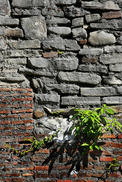 stones and bricks that make up Santa Maria church