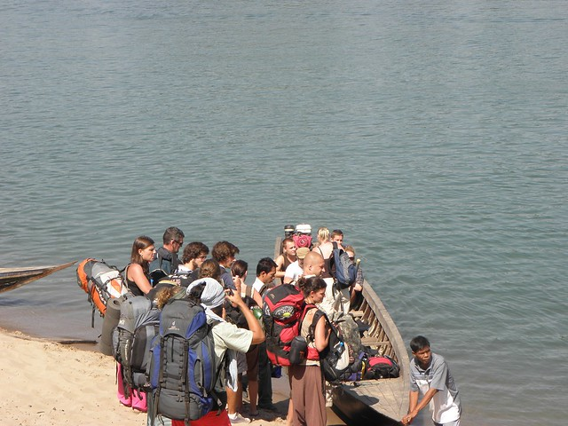 Backpackers getting off a boat in Laos