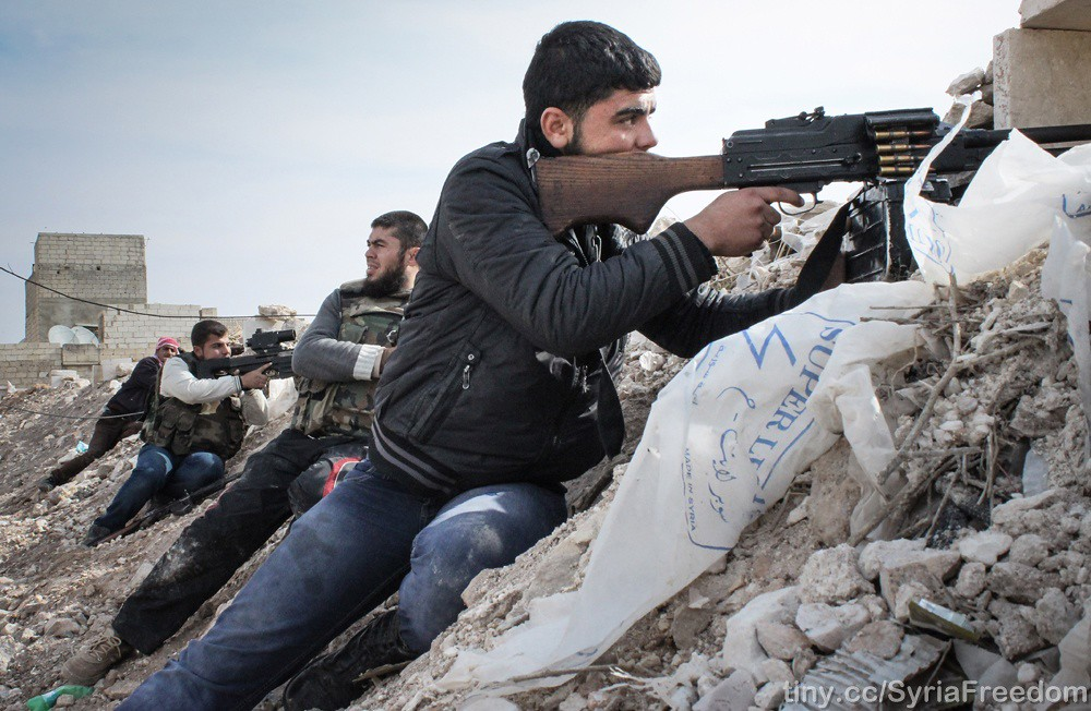 Free Syrian Army rebels fighting against Assad militias on the outskirts of the northwestern city of Maraat al-Numan, Idlib - Syria