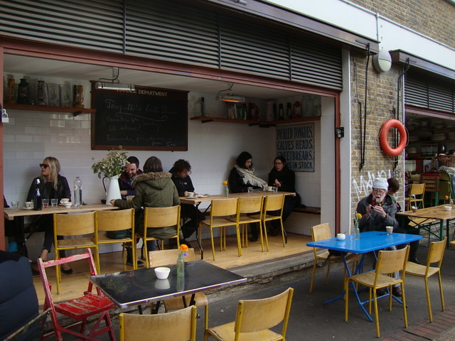 a cafe in refurbished boat storage facilities along The Canal