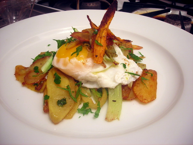 """Poached farm egg, pan-fried heirloom potatoes and cauliflower greens, with cumin carrot """"chips"""""""
