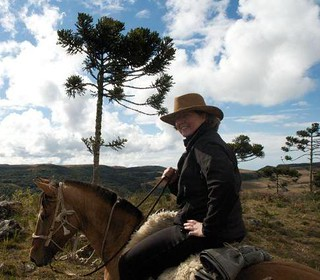 Ona Kiser on a Crioulo horse in Brazil.