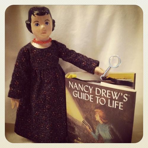 Hitty Hannah enjoying Nancy Drew's pearls of wisdom.