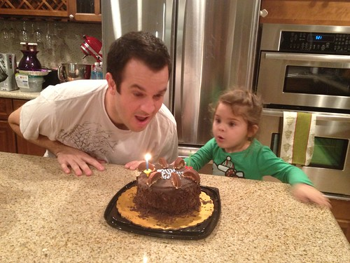 helping daddy blow out his candles