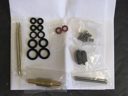 Rebuild Kit Left-to-Right, Jet Needles, O-Rings, Needle Jets, Throttle Plate Screws, Float Needles, Float Hinge Pin
