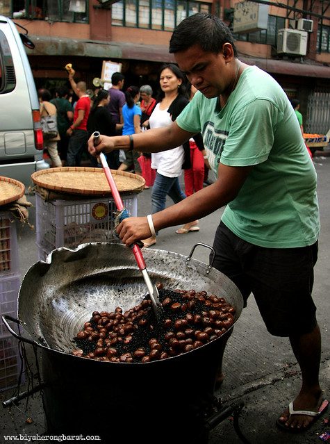 Man roasting chestnuts in Binondo Chinatown