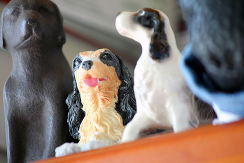 Dog statues on a shelf
