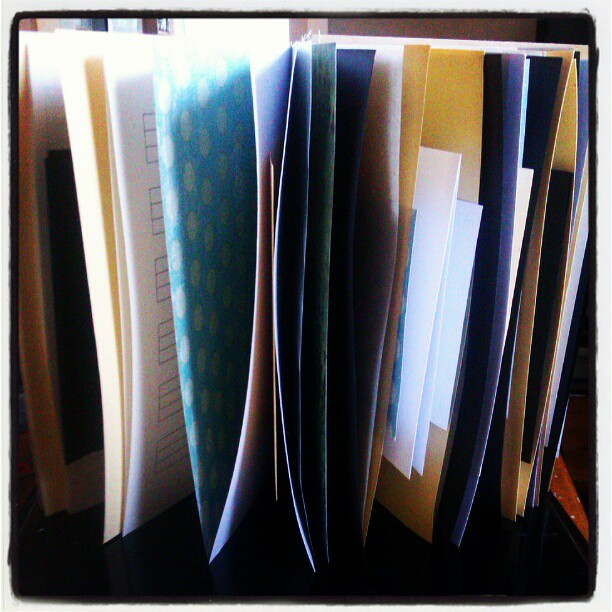 Binding a new book with lots of different papers. #bookbinding