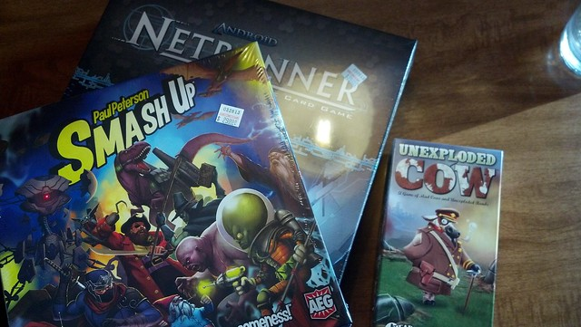 game boxes for SmashUp NetRunner and Unexploded Cow