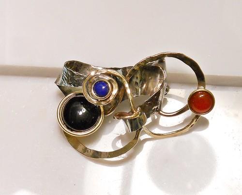 brooch nugold, nickelsilver, brass, onyx14mm, lapis lazuli7mm,Carnelian10mm by Wolfgang Schweizer