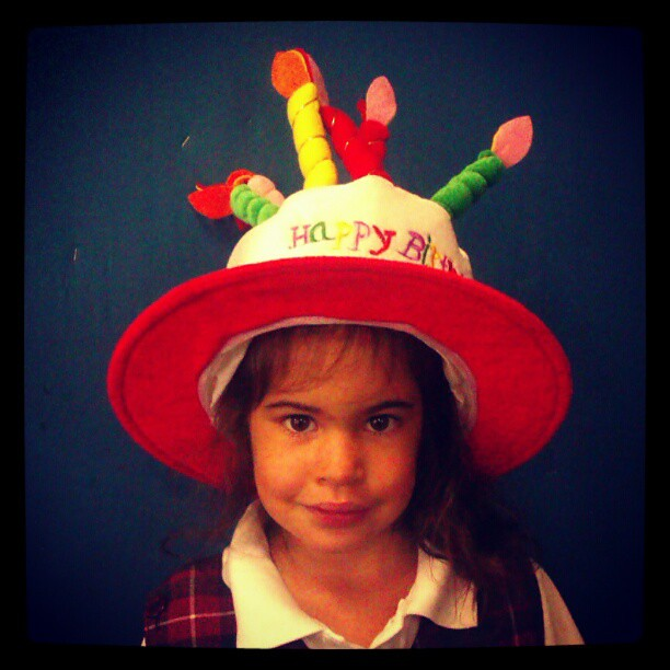 Proudly wearing her classroom's birthday hat. She has been waiting for this moment for a while. #sixtoday