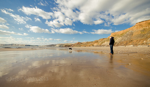 One man and his dog at Compton Bay, Isle of Wight.