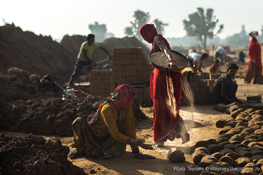 Women carry sand for brick production, Rajhastan