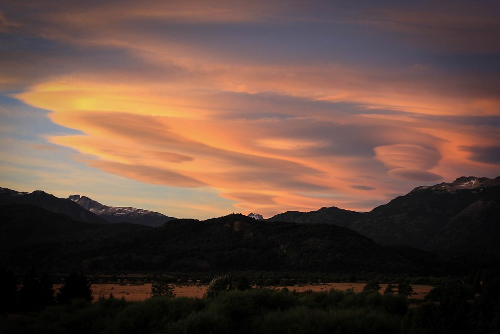 The Patagonian Sky at dusk. Lenticulars betray high winds. Lago Verde. Aysen. Patagonian Chile.