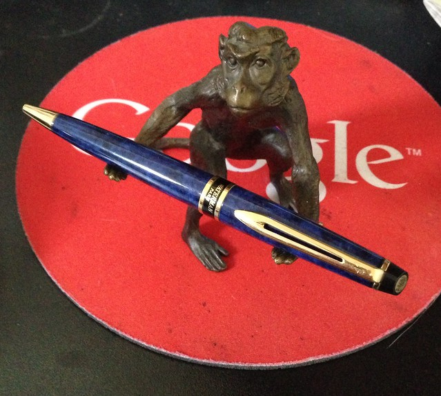 Pen monkey holds fountain pens