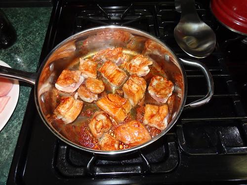 Caramelizing the pork belly.