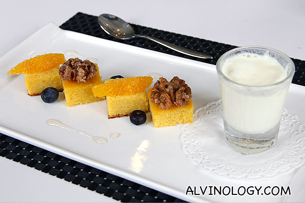 Orange flourless cake served with citrus segments and sweet walnuts