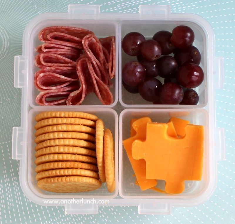 Lock & Lock bento lunch with puzzle cheese and crackers, salami and grapes