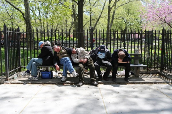 Five men sleeping on a bench
