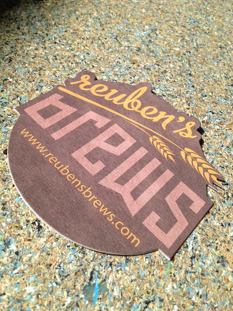 Reuben's Brews branded coaster
