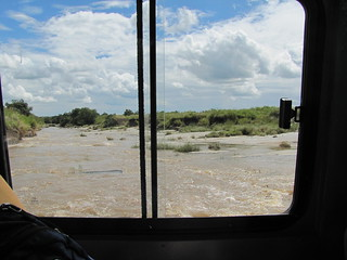 Crossing river in our Landcruiser