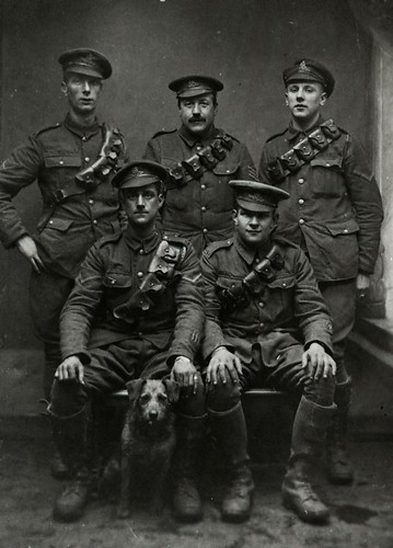 Five soldiers and a dog