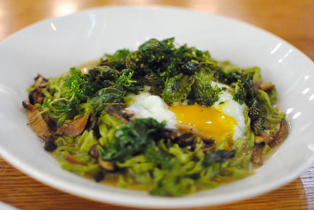 Tagliolini di Spinaci hand-cut spinach pasta, mushroom and artichoke ragu, poached farm egg, fried spinach