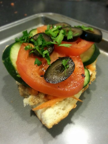 baba ganoush sandwich with shredded carrots,  cucumber and tomato slices, and black olives by pipsyq