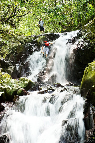 Climbing up a waterfall in a river in Taiwan