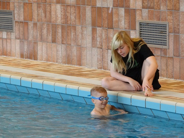Oldest and youngest, coach and swimmer