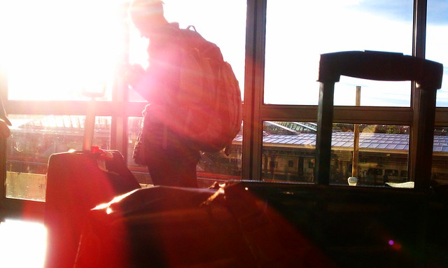 Photographing travelers and the sunset, while waiting for the Airtrain at JFK.