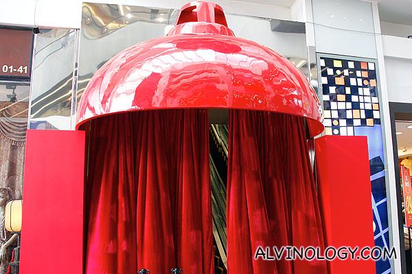 Giant red lampshade at the ground floor entrance inside Central mall