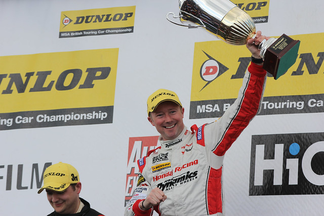 Gordon Sheddon with his trophy after winning at the BTCC race at Donington Park in April 2012